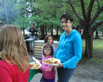 Mom and kids enjoying fish fry