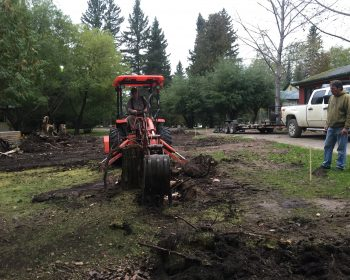 Many loads of trees and stumps removed, and time to dig foundation holes