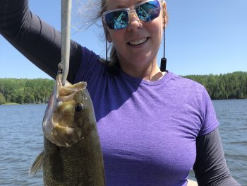 Cindy Jo with her 1st smallmouth bass caught on Perrault Lake