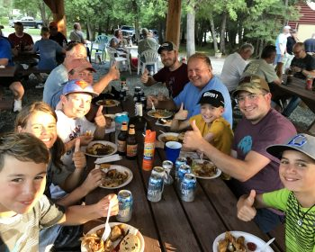Fathers and Sons enjoying the Rainbow Point Lodge fish fry