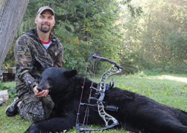 Bow Hunter with Black Bear