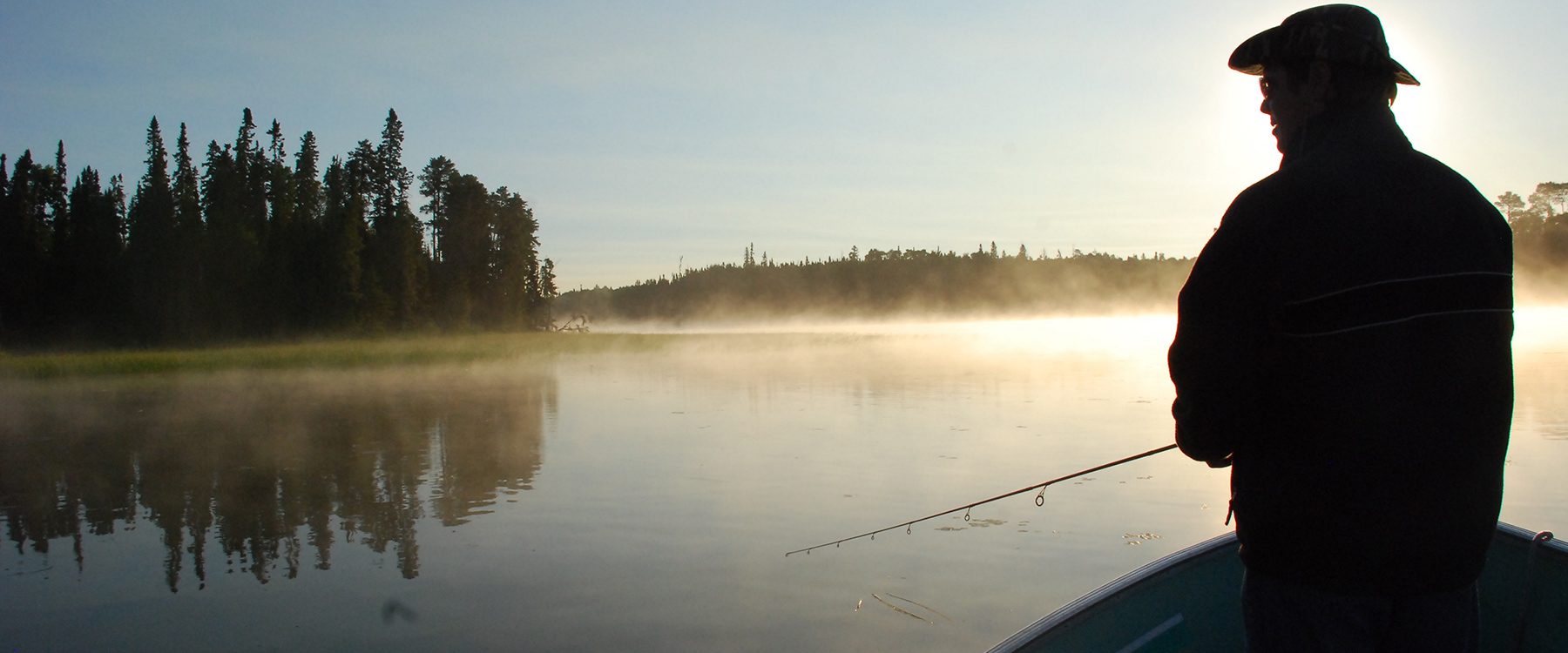 Guest Fishing on Lake in Morning Mist