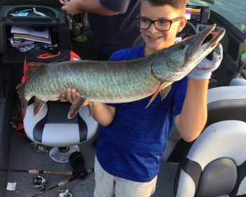 Young Mason caught this huge 40 inch muskie on Perrault Lake