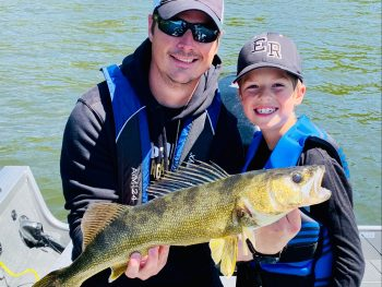 Father and Son Walleye Fishing at Rainbow Point Lodge at Perrault Falls, on Perrault Lake, Ontario, Canada
